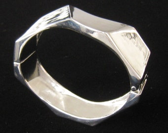 Modernist Clamper Bracelet is Covered in Rich Shiny Silver Plating.  Outer Surface has 8 Angled Planes for a Heavy Industrial Look.