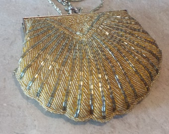 Vintage La Regale small  beaded purse golden color with long chain.