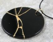 Kintsugi (kintsukuroi) inspired black onyx round pendant with gold repair on black cotton cord - OOAK