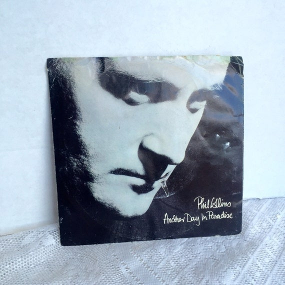 record phil collins another day in paradise 7 inch record. Black Bedroom Furniture Sets. Home Design Ideas