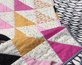 Pink, honey, black and white quilt. Modern but timeless. Great for young and old