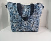 Handmade quilted tote bag in shades of blue zippered pockets and closure