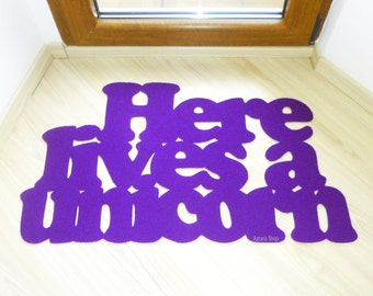 "Cool door mat ""Here lives a unicorn"". Funny doormat. Welcome rug. Home decor. Gifts for home"