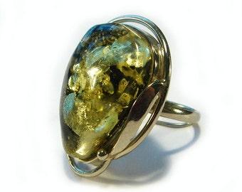 Natural Baltic green amber ring.