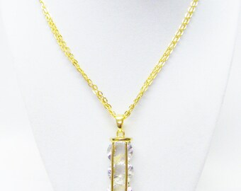 Geometric Gold Plated Hollow Column w/ Floating Glass Beads Pendant Necklace