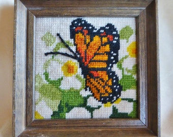 Vintage framed needlepoint of Monarch butterfly and flower in wood frame