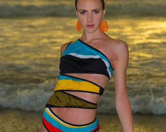 Stripey Sea; Asymmetric swimsuit cleverly cut from striped jersey fabric and edged in black stretchy binding