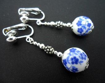 A pair of cute porcelain flower  bead   dangly clip on earrings.