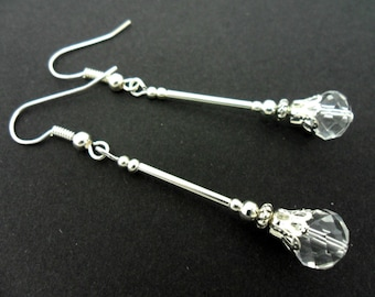 A pair of pretty silver plated clear crystal  dangly earrings.