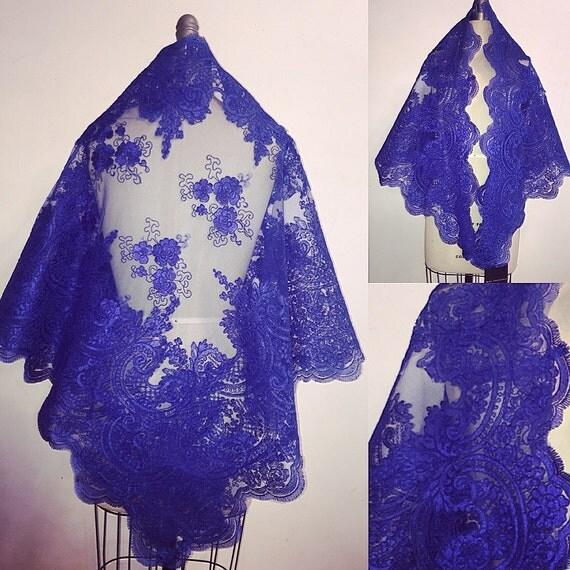 Irina Shabayeva Royal blue lace shawl with scalloped lace edges.