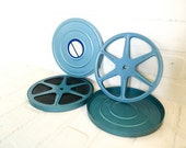 Pair of Blue Metal Logan Roll-EZ Film Reels and Canisters