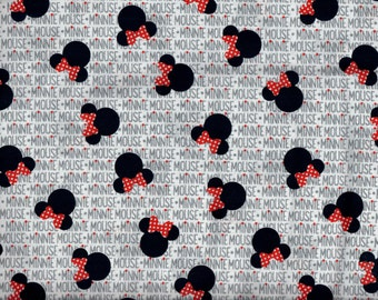 Minnie Mouse heads and bows fabric -  black head silhouettes with red and white bows and name in gray - Disney - by the YARD