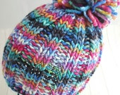 Hand knit wool hat with pompom