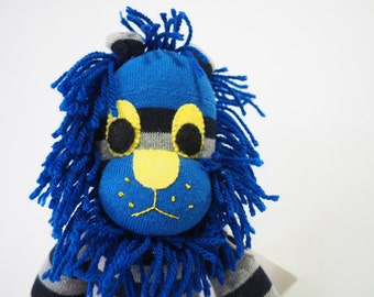 Linus Lion. Sock animal, sock lion, sock monkey, soft plush toy for children.