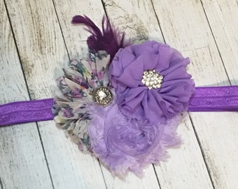 Purple flower elastic foe heaband with feather