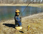 Chainsaw Carving Fishing Black Bear In Blue Bibs and Hat with Fishing Pole and Bait