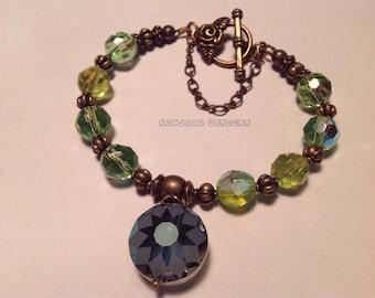 Bronze Green Glass Beaded Bracelet .