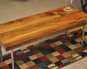 Metal leg cypress coffee table, with provincial stain