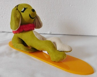 vintage DAKIN DREAM PETS lounging dog on surf board