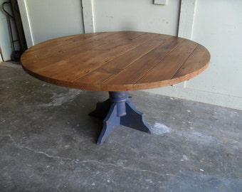 Round Dining table made from reclaimed wood in the USA