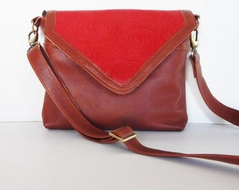 Brown leather crossbody bag, with red embossed leather trim. Brown leather purse with red trim.
