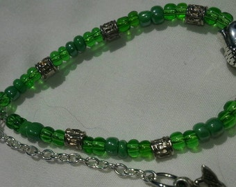 Buddha Green Zen Bracelet 6 inch expands to 7 3/4 inches.