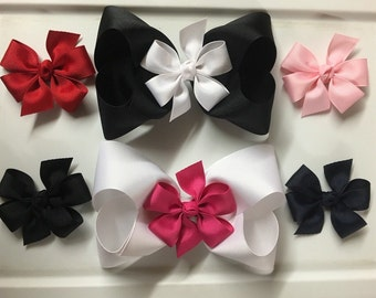 "Pick 2 XXL bows and 6 piggy back bows U Pick colors/list them in ""note to seller"" at checkout."