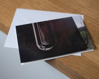 Asleep beneath the sleepers - a moonlit, long exposure landscape. Fine art photography greetings card. Blank inside.