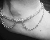Silver colored anklet...