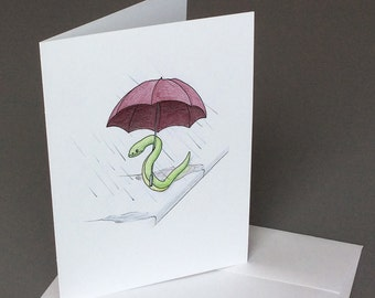 Snake caught in the rain with red umbrella