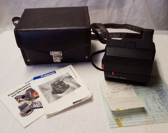 Polaroid One Step Camera, case, owners guide, Polaroid Accessory and Gift Catalog and the original purchase receipt