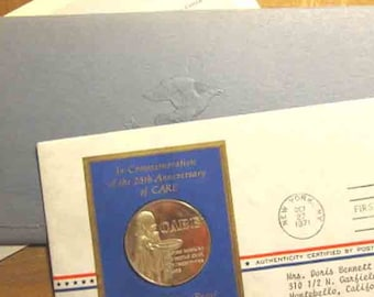 25th Anniversary coin of CARE Limited Edition Sterling Silver in sleeve from U S Postmaster of America - FIrst Day issue
