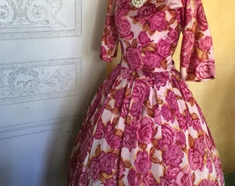 1950s party dress with a violet and gold rose print.  50s taffeta dress with a full skirt.