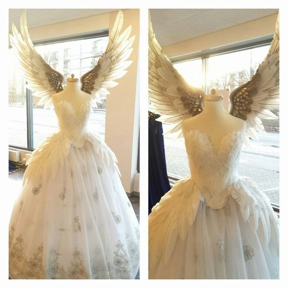 Items similar to white swan silver feather wedding dress for White feather wedding dress