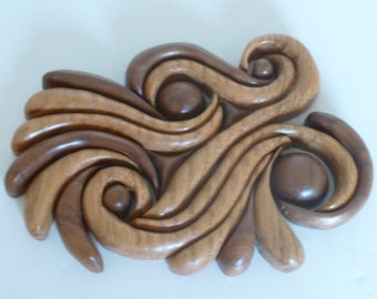 Space Swirl, twin mirrored abstract intarsia sculptures