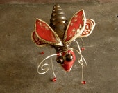 ceramic beetle, red and bronze