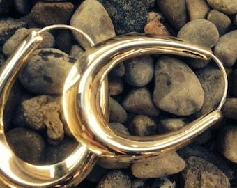 Sterling silver oval puffed hoop earrings