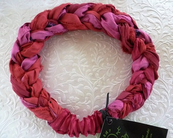 A deep rose iridescent sari silk hand braided beautifully into my unique headband to warm hair and skin tones