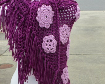 Crocheted shawl with appliqued flowers
