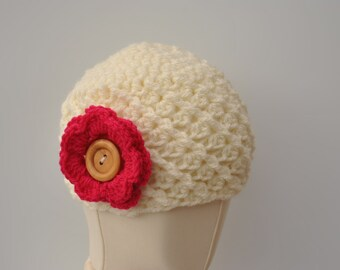 Crocheted beanie hat for 3-6 months with interchangeable flowers