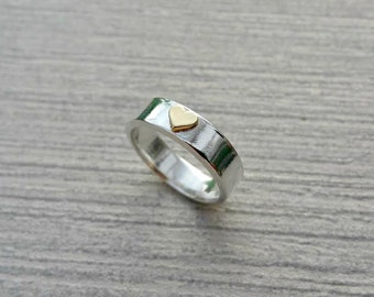 Sterling silver ring with brass heart