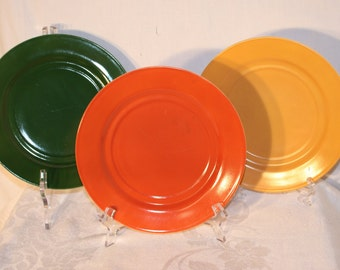 3 Anchor Hocking 8 7/8 inch glass dinner plates, orange, dark green, gold, in great condition