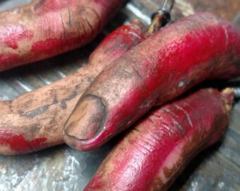 Creepy dirty bloody finger necklace hangs long on hemp cord