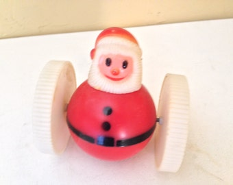 Vintage Hard Plastic  Santa Rolly Polly Wheels Toy- Made in Hong Kong