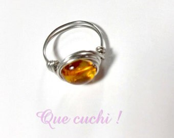 Silver ring with a stone rolled Amber