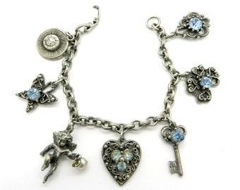 Coro Charm Bracelet, Vintage Silver Tone Rhinestone Cupid Heart Key Flowers Blue Rhinestone Charm Bracelet