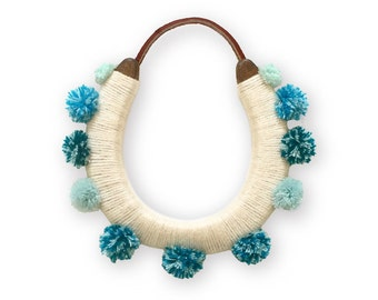 lucky yarn wrapped pom pom horseshoe