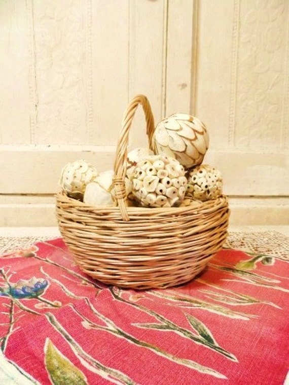wicker basket filled with decorating balls simple country chic decor