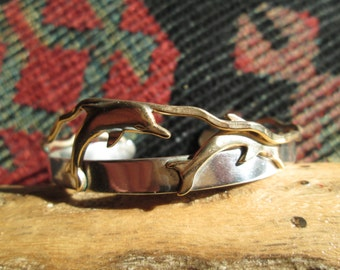 Sterling Silver and Brass Swimming Dolphins Cuff Bracelet by Courtney Peterson