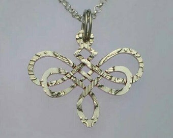 Celtic Dragonfly cut from a Kennedy half dollar coin jewelry